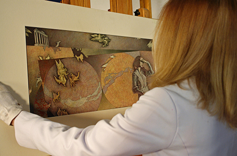 MPI technician moves artwork to easel
